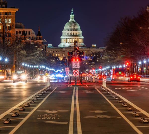 US Capitol building at night from street level